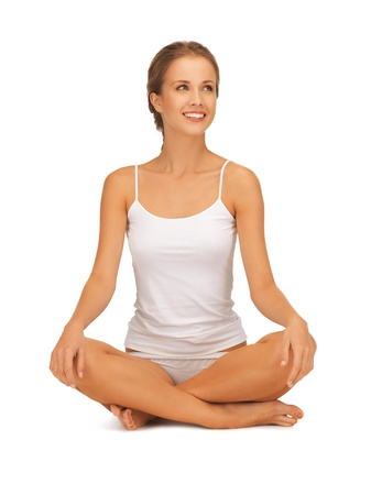 sporty woman in cotton undrewear practicing yoga lotus pose Stock Photo - 16937610