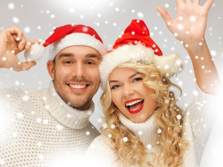 picture of family couple in sweaters and santa s hats Stock Photo - 16937537