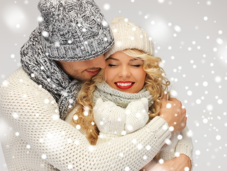 couple cuddling: bright picture of family couple in a winter clothes Stock Photo