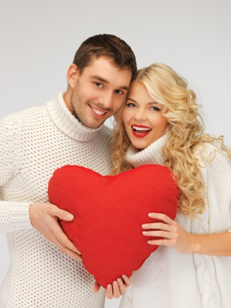 picture of family couple in a sweaters with heart photo