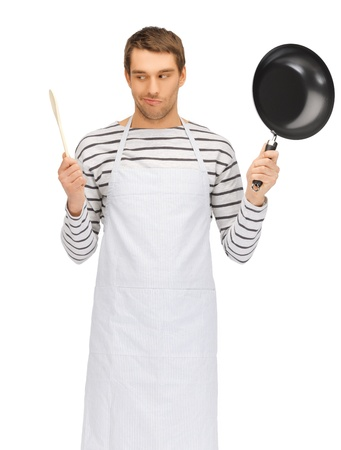 bright picture of handsome man with pan and spoon photo