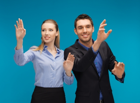picture of man and woman working with something imaginary Stock Photo - 16960791