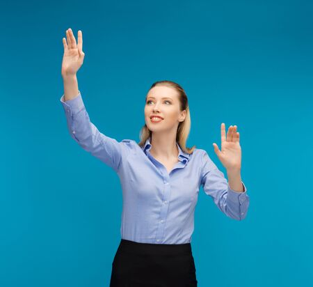 bright picture of woman working with something imaginary Stock Photo - 16960788
