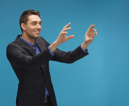 picture of man in suit working with something imaginary  photo