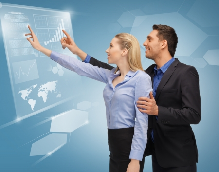 picture of man and woman working with virtual touch screens photo