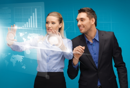 picture of man and woman working with virtual touch screens Stock Photo - 16960783