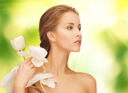 picture of beautiful woman with orchid flower Stock Photo - 16972432