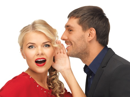bright picture of man and woman spreading gossip  focus on woman  photo