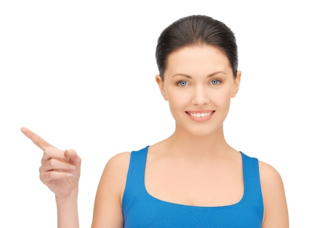 bright picture of beautiful woman pointing her finger Stock Photo - 16972406