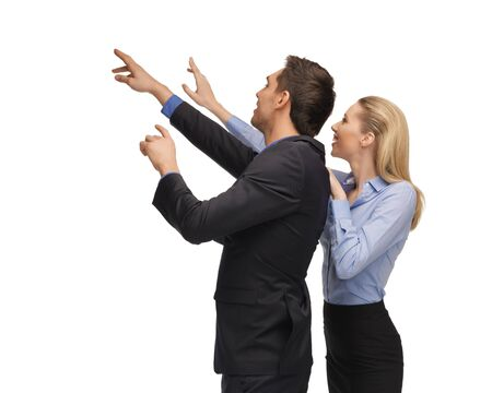 picture of man and woman working with something imaginary  photo