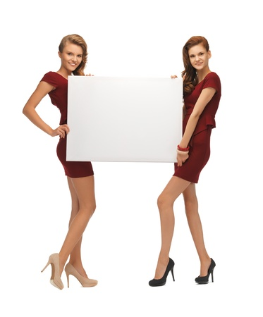 picture of two teenage girls in red dresses with blank board photo