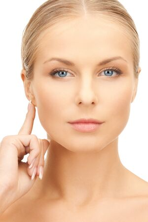 picture of beautiful woman pointing to ear photo