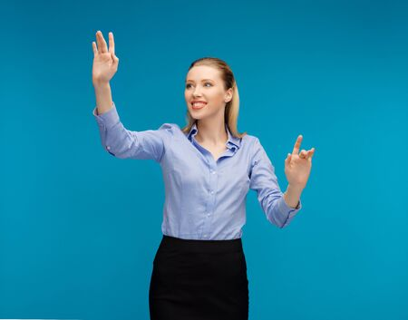 bright picture of woman working with something imaginary Stock Photo - 16972431