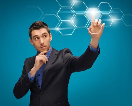 picture of man in suit working with virtual screens Stock Photo - 16972390