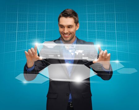 picture of man in suit working with virtual screens Stock Photo - 16972420