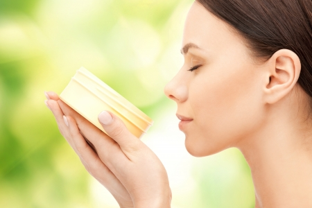 moisturizing: picture of beautiful woman with moisturizing creme