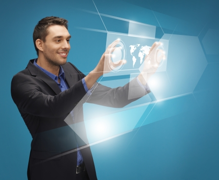 picture of man in suit working with virtual screens photo