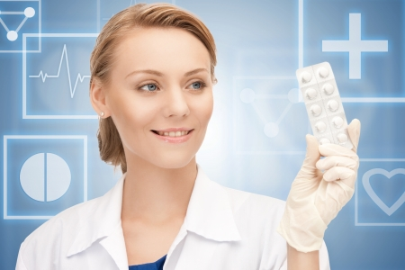 drug control: picture of attractive female doctor with pills