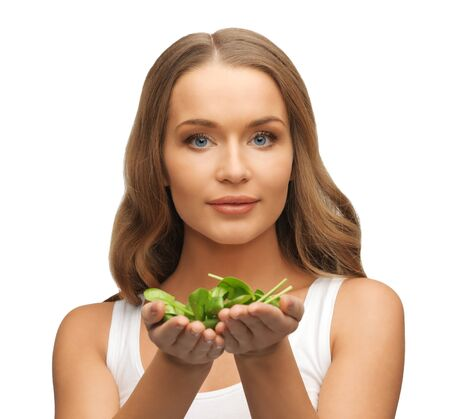 bright picture of woman with spinach leaves on palms Stock Photo - 17039705