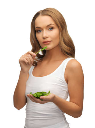 bright picture of woman with spinach leaves on palms Stock Photo - 17039718
