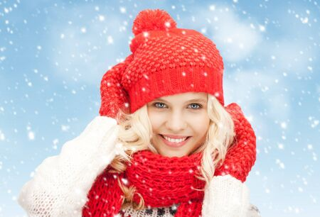 bright picture of beautiful woman in hat, muffler and mittens Stock Photo - 17038980