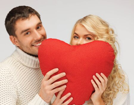 picture of family couple in a sweaters with heart  focus on man  Stock Photo - 17038934