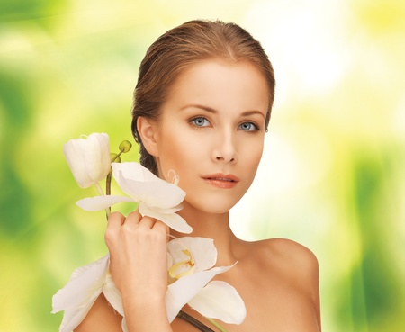 picture of beautiful woman with orchid flower Stock Photo - 17038986