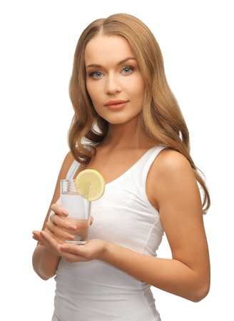 picture of woman with lemon slice on glass of water   Stock Photo - 17038984