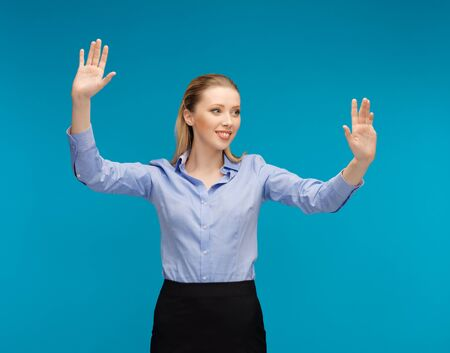 bright picture of woman working with something imaginary photo
