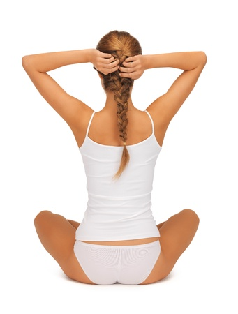 sporty woman in cotton undrewear practicing yoga lotus pose photo