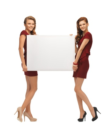picture of two teenage girls in red dresses with blank board Stock Photo - 17038632