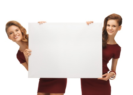 picture of two teenage girls in red dresses with blank board Stock Photo - 17038635