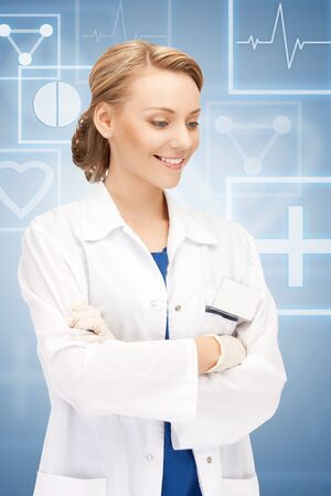 bright picture of an attractive female doctor Stock Photo - 17108128