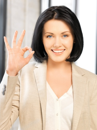 bright picture of young woman showing ok sign Stock Photo - 17108171