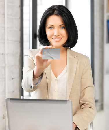 picture of happy woman with laptop computer and credit card Stock Photo - 17055291