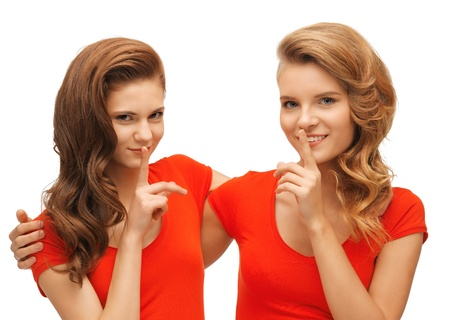 picture of two teenage girls showing hush gesture Stock Photo - 17098780