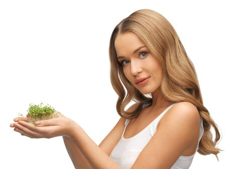 bright picture of woman with green grass on palms Stock Photo - 17093151