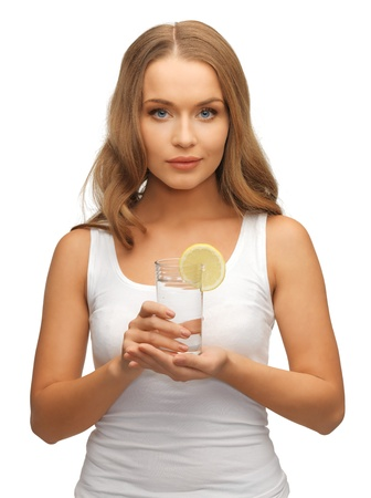 picture of woman with lemon slice on glass of water Stock Photo - 17093313