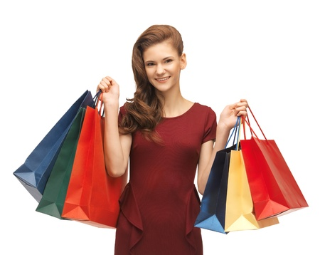 picture of teenage girl in red dress with shopping bags Stock Photo - 17093183