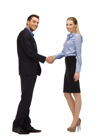 bright picture of man and woman shaking their hands Stock Photo - 17093312