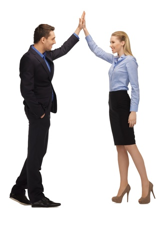 bright picture of man and woman giving a high five  photo