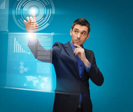 picture of man in suit working with virtual screens Stock Photo - 17093420