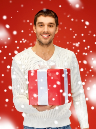 bright picture of handsome man with a gift   photo