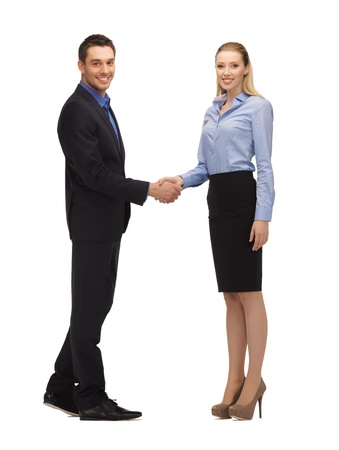 bright picture of man and woman shaking their hands  Stock Photo - 17155455