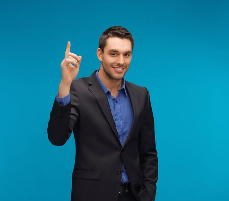 picture of man in suit with his finger up Stock Photo - 17155551