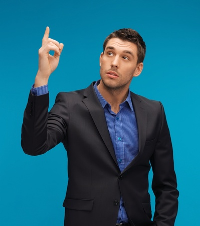 picture of man in suit with his finger up Stock Photo - 17165752
