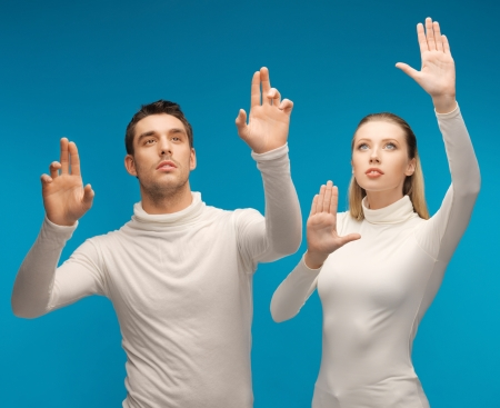 picture of man and woman working with something imaginary Stock Photo - 17165767