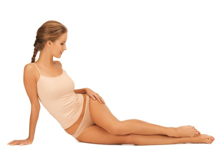 slender: beautiful woman in cotton underwear touching her legs