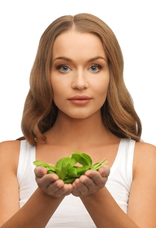 bright picture of woman with spinach leaves on palms Stock Photo - 17193763