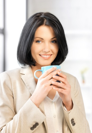 bright picture of lovely businesswoman with mug  photo